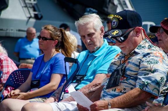 140718-IG780-N-073 NORFOLK, Va. (July 18, 2014) - Bernard Groenewald, left, a surviving member of aircraft carrier USS Franklin (CV 13), and Ron Williams, sponsor of the 2014 Franklin Reunion, read the names of the most recently deceased survivors of Franklin on board battleship USS Wisconsin (BB 64). The annual meeting of the Franklin Society honors the men who served aboard Franklin during World War II. (U.S. Navy photo by Mass Communication Specialist 3rd Class Shane A. Jackson/Released)