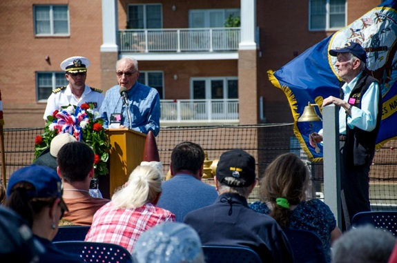 140718-IG780-N-080 NORFOLK, Va. (July 18, 2014) – Bill Albrecht, a surviving member of aircraft carrier USS Franklin (CV 13), reads the names of the most recently deceased survivors of Franklin on board battleship USS Wisconsin (BB 64). The annual meeting of the Franklin Society honors the men who served aboard Franklin during World War II. (U.S. Navy photo by Mass Communication Specialist 3rd Class Shane A. Jackson/Released)